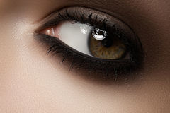 Beauty cosmetics. Macro fashion smoky eyes make-up Royalty Free Stock Photos