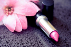Beauty & cosmetics: pink lipstick & soft flower Royalty Free Stock Image