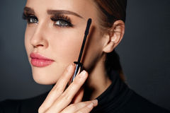 Beauty Cosmetics. Woman Putting Black Mascara On Long Eyelashes Stock Photography