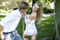 Beauty couple in garden Royalty Free Stock Photo