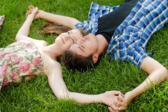 Beauty couple in love embracing lying outdoors Stock Photo