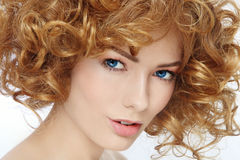 Beauty with curly hair royalty free stock images