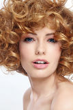 Beauty with curly hair. Portrait of young beautiful woman with curly hair royalty free stock images