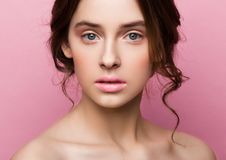 Beauty cute fashion model with natural make up. On pink background royalty free stock photography