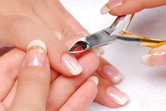Beauty cuticle. Nail salon - Cut cuticle on the female forefinger stock images