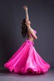 Beauty dancer performing oriental dance. Full length portrait of pretty dancer performing oriental dance Royalty Free Stock Image
