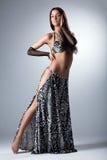 Beauty dancer posing in arabian costume Stock Image