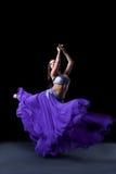 Beauty dancer posing in dark with fly purple veil Stock Photos