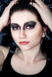 Beauty with dark make-up in the water Stock Images