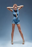 Beauty, denim blue jeans overalls royalty free stock image