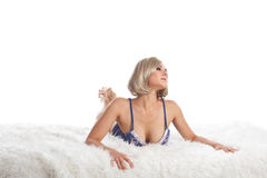 Beauty desired woman lay on fur in lingerie Stock Photos