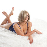 Beauty desired  woman lay on fur in lingerie Royalty Free Stock Photos
