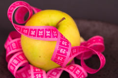 Beauty and diet: apple and measuring tape Stock Photography