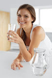 Beauty, Diet Concept. Happy Smiling Woman Drinking Water. Health royalty free stock images