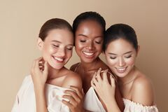 Beauty. Diverse Group Of Ethnic Women Portrait. Happy Different Ethnicity Models Standing Together With Closed Eyes And Smiling.