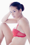 Beauty dressed in red lingerie mesmerising Stock Photography