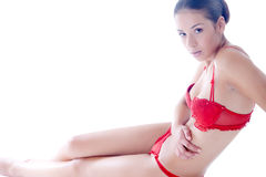 Beauty dressed in red lingerie seeking contact Stock Photos