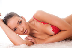 Beauty dressed in red lingerie wondering Royalty Free Stock Images