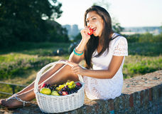 Beauty eating fruit Royalty Free Stock Images