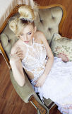 Beauty emotional blond bride in luxury interior Royalty Free Stock Images
