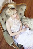 Beauty emotional blond bride in luxury interior Royalty Free Stock Image