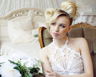 Beauty emotional blond bride in luxury interior Royalty Free Stock Photography