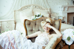 Beauty emotional blond bride in luxury interior Stock Image