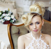 Beauty emotional blond bride in luxury interior Royalty Free Stock Photo