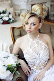 Beauty emotional blond bride in luxury interior Royalty Free Stock Photos