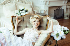 Beauty emotional blond bride in luxury interior Stock Photo
