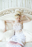 Beauty emotional blond bride in luxury interior Stock Photos