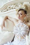 Beauty emotional blond bride in luxury interior Stock Images