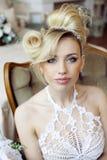 Beauty emotional blond bride in luxury interior Stock Photos