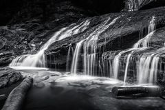 Beauty of Empress Falls. After its big drop Empress Falls cascades over these rocks into a shallow pool stock image