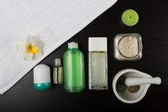 Beauty essentials. Beauty and spa treatment essentials on a dark wooden background Royalty Free Stock Image