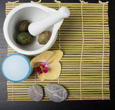Beauty essentials. Beauty and spa treatment essentials on a dark wooden background Stock Photo