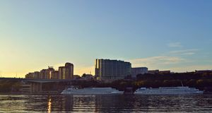 The beauty of the evening city. Is indescribable. clear water, city houses, bridge Stock Photography