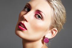Beauty with evening make-up, bright lips & jewelry Royalty Free Stock Photography