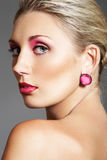 Beauty with evening make-up, bright lips & jewelry Stock Photos