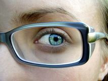 Beauty eye. With glass for advertisement stock photos