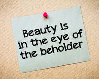 Beauty is in the eye of the beholder. Message. Recycled paper note pinned on cork board. Concept Image Stock Images