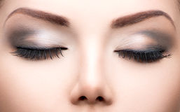 Beauty eyes makeup closeup. Long eyelashes, perfect skin Stock Images