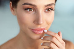 Beauty Face. Beautiful Woman Touching Lips With Lip Balm On. Beauty Face. Beautiful Woman With Natural Makeup And Full Lips Touching Her Mouth. Closeup Portrait stock photos