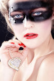 Beauty face in black airbrush and jewelery Royalty Free Stock Photography