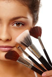 Beauty face and brushes Stock Photos
