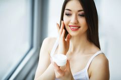 Beauty Face Care. Woman Applying Cream On Skin. Beauty Face Care. Woman Applying Cream On Skin Stock Photos