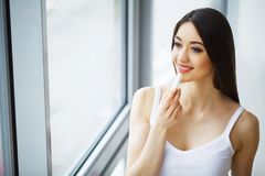 Beauty Face Care. Woman Applying Cream On Skin. Beauty Face Care. Woman Applying Cream On Skin Royalty Free Stock Images