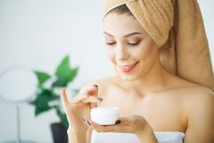 Beauty Face Care. Woman Applying Cream On Skin. Beauty Face Care. Woman Applying Cream On Skin Royalty Free Stock Image