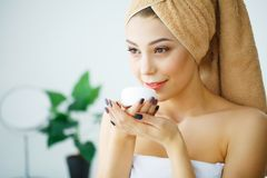 Beauty Face Care. Woman Applying Cream On Skin. Beauty Face Care. Woman Applying Cream On Skin Royalty Free Stock Photography