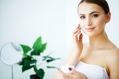 Beauty Face Care. Woman Applying Cream On Skin. Beauty Face Care. Woman Applying Cream On Skin Royalty Free Stock Photo